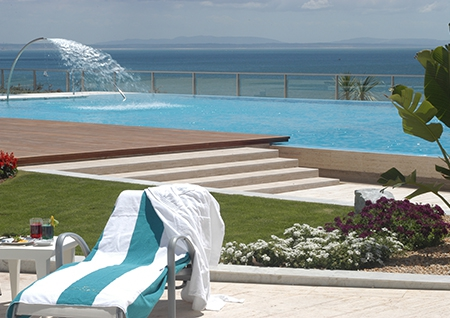 Hotel pool area with sea view