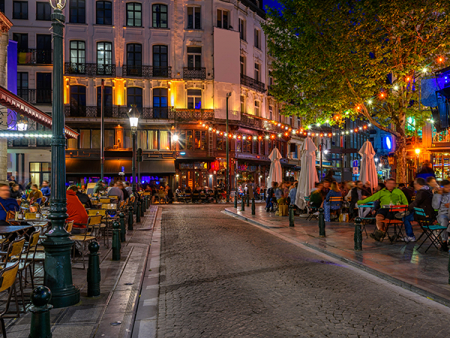 Colourful Rue des Bouchers, jam-packed with pavement tables